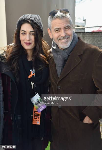 Amal Clooney and George Clooney attend March For Our Lives on March 24 2018 in Washington DC