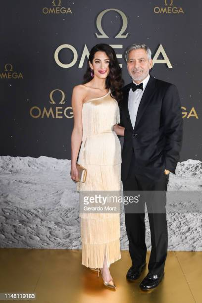 Amal Clooney and George Clooney attend OMEGA 50th Anniversary Moon Landing Event on May 09, 2019 in Orlando, Florida.