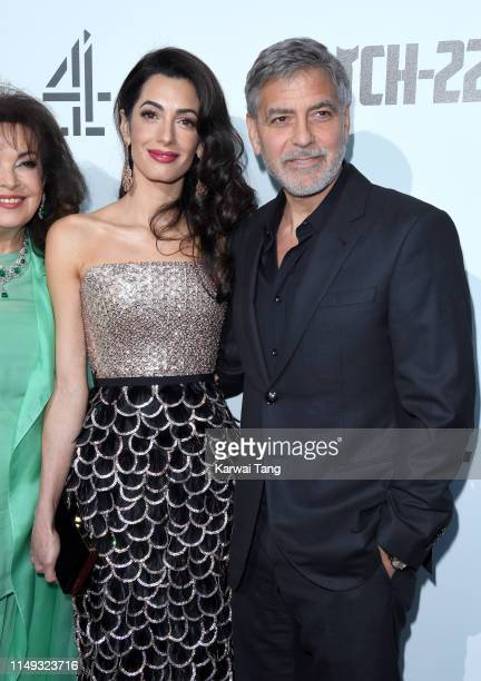 """Amal Clooney and George Clooney attend the """"Catch 22"""" UK premiere at the Vue Westfield on May 15, 2019 in London, United Kingdom."""