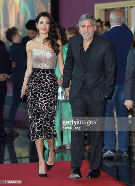 Amal Clooney and George Clooney attend the Catch 22 UK premiere at the Vue Westfield on May 15 2019 in London United Kingdom