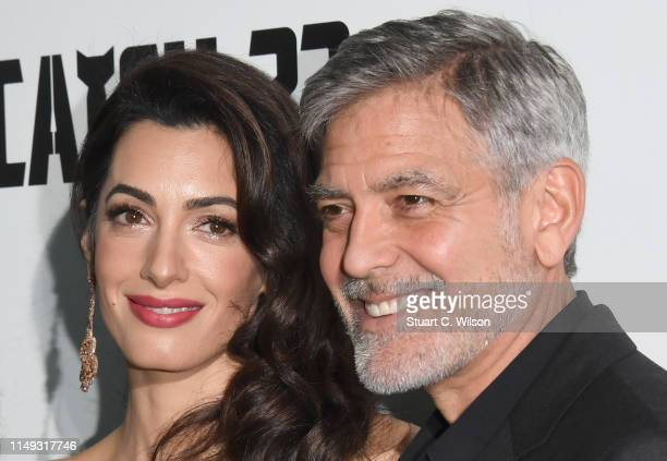 """Amal Clooney and George Clooney attend the """"Catch 22"""" UK premiere on May 15, 2019 in London, United Kingdom."""