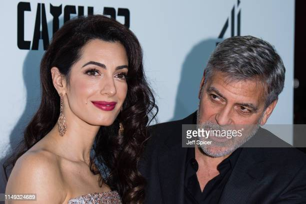 Amal Clooney and George Clooney attend the Catch 22 UK premiere on May 15 2019 in London United Kingdom