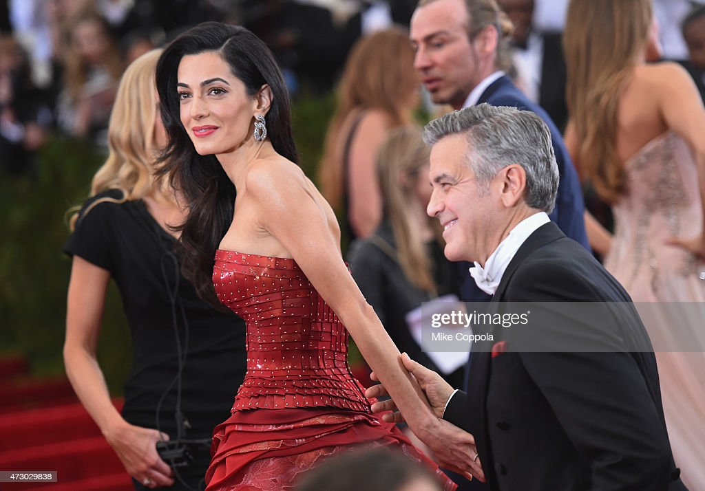 Amal Clooney (L) and George Clooney attend the 'China: Through The Looking Glass' Costume Institute Benefit Gala at the Metropolitan Museum of Art on May 4, 2015 in New York City.