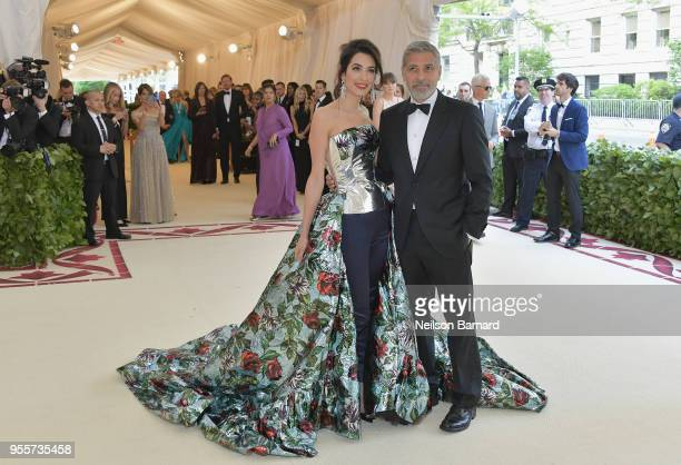 Amal Clooney and George Clooney attend the Heavenly Bodies Fashion The Catholic Imagination Costume Institute Gala at The Metropolitan Museum of Art...