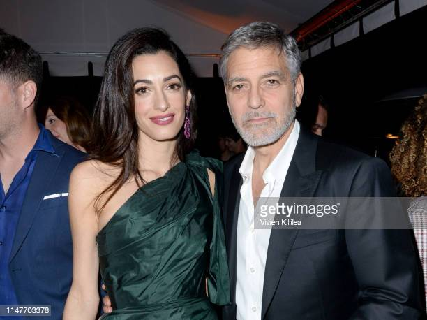 """Amal Clooney and George Clooney attend the premiere of Hulu's """"Catch-22"""" on May 07, 2019 in Hollywood, California."""