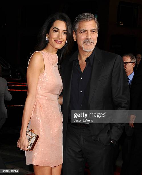 Amal Clooney and George Clooney attend the premiere of 'Our Brand Is Crisis' at TCL Chinese Theatre on October 26 2015 in Hollywood California