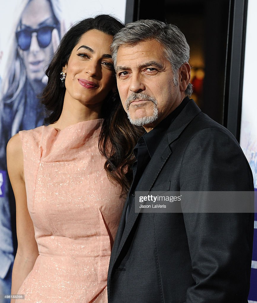 Amal Clooney and George Clooney attend the premiere of 'Our Brand Is Crisis' at TCL Chinese Theatre on October 26, 2015 in Hollywood, California.