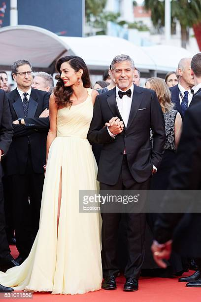 Amal Clooney and George Clooney attend the screening of Money Monster at the annual 69th Cannes Film Festival at Palais des Festivals on May 12 2016...