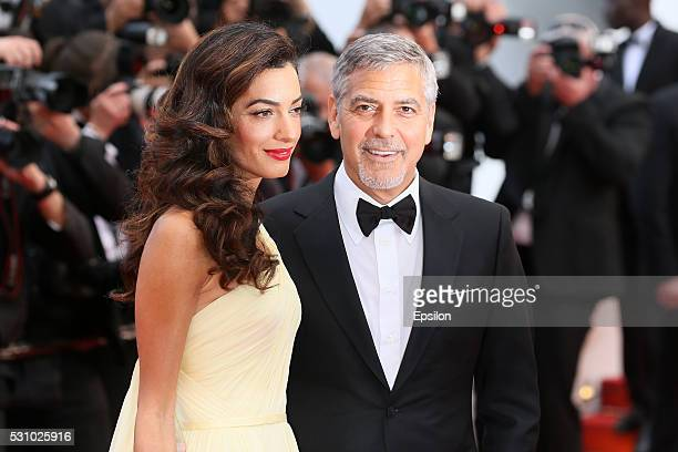Amal Clooney and George Clooney attend the screening of 'Money Monster' at the annual 69th Cannes Film Festival at Palais des Festivals on May 12...