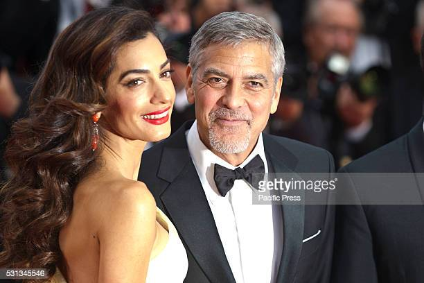 Amal Clooney and George Clooney attend the screening of 'Money Monster' at the annual 69th Cannes Film Festival at Palais des Festivals in Cannes...