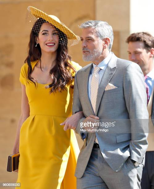 Amal Clooney and George Clooney attend the wedding of Prince Harry to Ms Meghan Markle at St George's Chapel Windsor Castle on May 19 2018 in Windsor...
