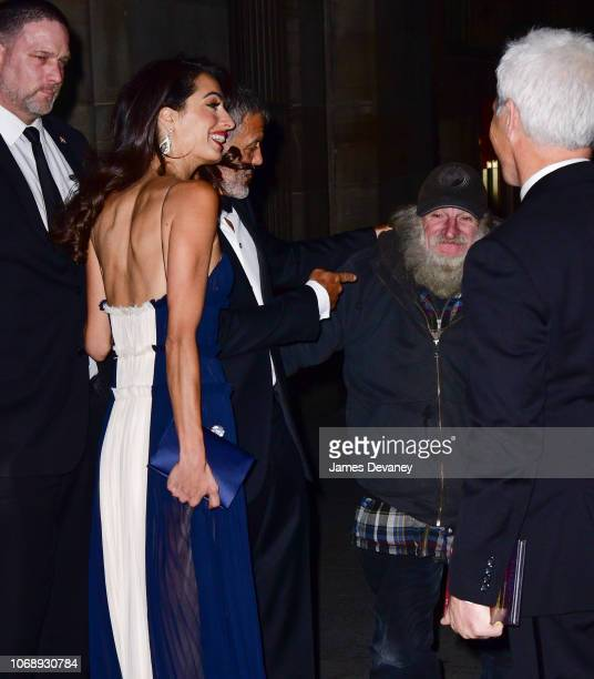 Amal Clooney and George Clooney greet Radioman outside Cipriani 42nd Street on December 5 2018 in New York City