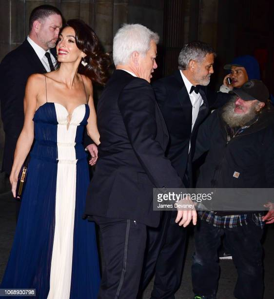 Amal Clooney and George Clooney greet Radioman outside Cipriani 42nd Street on December 5, 2018 in New York City.