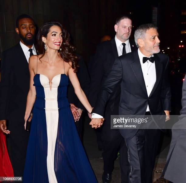 Amal Clooney and George Clooney leave Cipriani 42nd Street on December 5, 2018 in New York City.