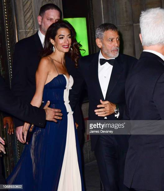 Amal Clooney and George Clooney leave Cipriani 42nd Street on December 5 2018 in New York City
