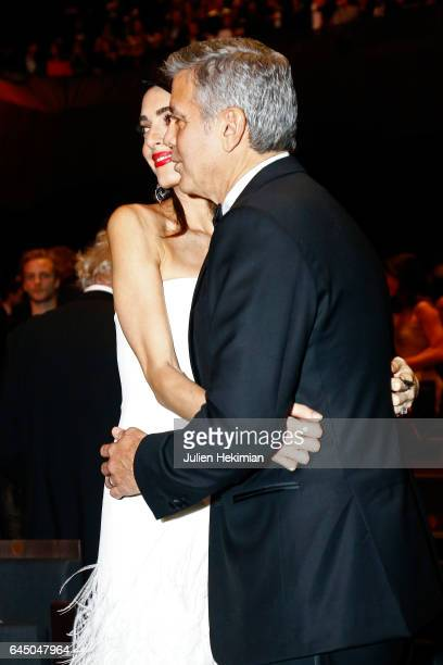 Amal Clooney and george Clooney pose on stage during the Cesar Film Awards Ceremony at Salle Pleyel on February 24 2017 in Paris France