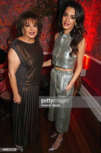 Amal Clooney and mother Baria Alamuddin attend Charlotte Tilbury's naughty Christmas party celebrating the launch of Charlotte's new flagship beauty...