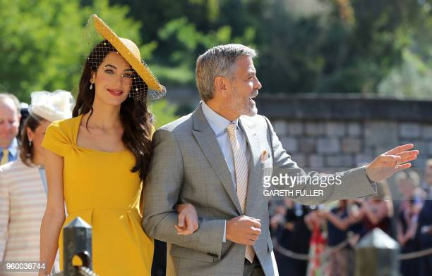 Amal Clooney and US actor George Clooney arrive for the wedding ceremony of Britain's Prince Harry Duke of Sussex and US actress Meghan Markle at St...
