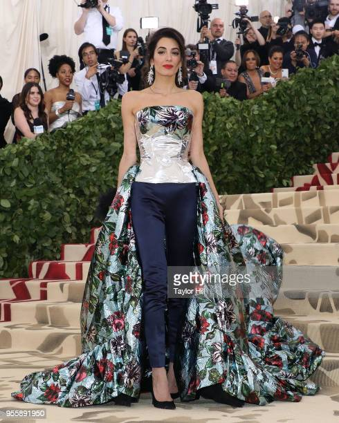 Amal Clooney attends 'Heavenly Bodies Fashion the Catholic Imagination' the 2018 Costume Institute Benefit at Metropolitan Museum of Art on May 7...