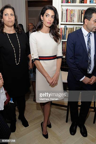 Amal Clooney attends the Women In The World reception honoring appointment of UN Office on Drugs and Crime Goodwill Ambassador Nadia Murad on...