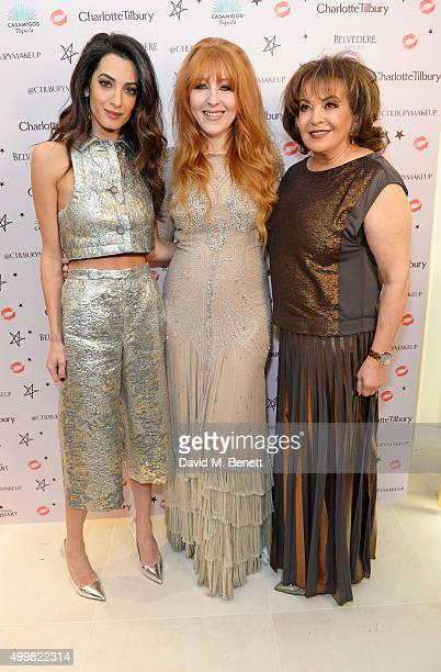 Amal Clooney Charlotte Tilbury and Amal's mother Baria Alamuddin attend Charlotte Tilbury's naughty Christmas party celebrating the launch of...