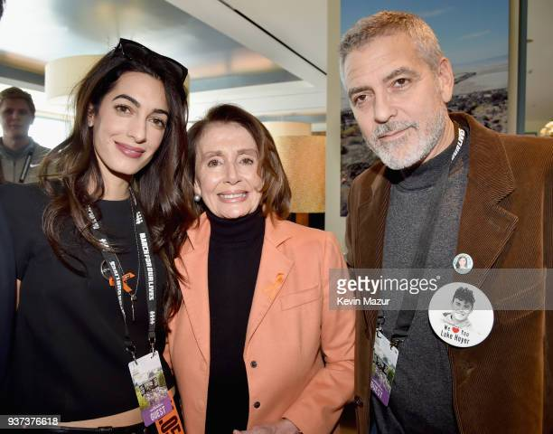 Amal Clooney Congresswoman Nancy Pelosi and George Clooney attend March For Our Lives on March 24 2018 in Washington DC