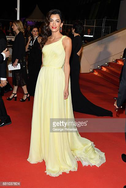 Amal Clooney departs from the screening of 'Money Monster' at the annual 69th Cannes Film Festival at Palais des Festivals on May 12 2016 in Cannes...