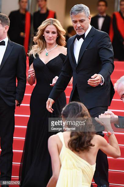 Amal Clooney George Clooney and Julia Roberts attend the screening of Money Monster at the annual 69th Cannes Film Festival at Palais des Festivals...