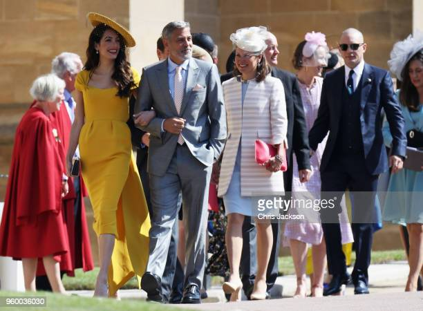 Amal Clooney George Clooney and Tom Hardy arrive at the wedding of Prince Harry to Ms Meghan Markle at St George's Chapel Windsor Castle on May 19...
