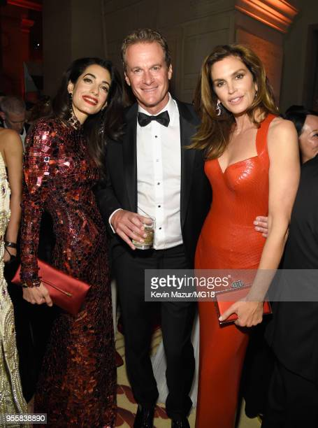 Amal Clooney Rande Gerber and Cindy Crawford attend the Heavenly Bodies Fashion The Catholic Imagination Costume Institute Gala at The Metropolitan...