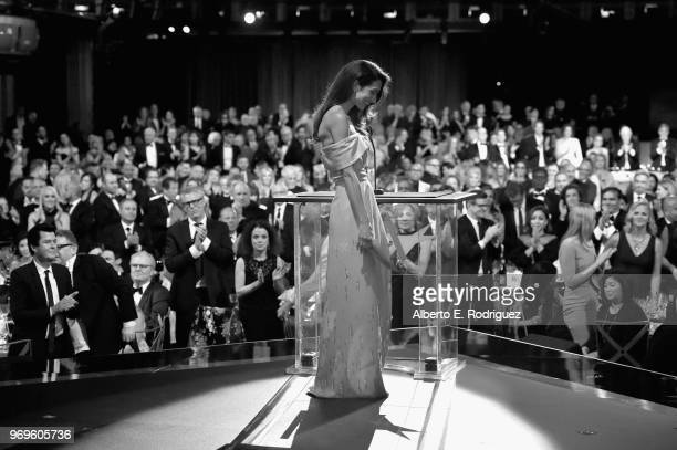 Amal Clooney speaks onstage during the American Film Institute's 46th Life Achievement Award Gala Tribute to George Clooney at Dolby Theatre on June...