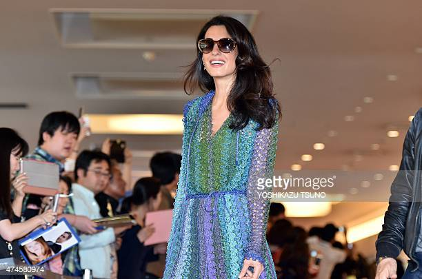 Amal Clooney wife of US movie star George Clooney smiles to the press upon her arrival at Haneda airport in Tokyo on May 24 2015 George Clooney is...
