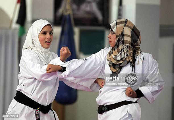 Amal Mohammed Dayana Kolak young females in Gaza working hard to specialize in Karate practicing on Gaza beach February 17 2014