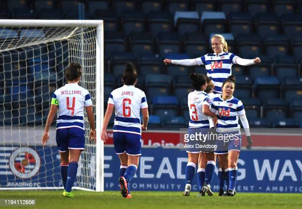 Amalie Eikeland of Reading Women celebrates with teammates after scoring her team's third goal during the Barclays FA Women's Super League match...