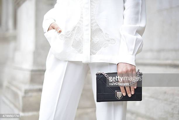 Amalie Gassman poses wearing an Alexis Mabille shirt Zara pants and Dior bag before the Alexis Mabille presentation at the Opera Garnier on July 8...