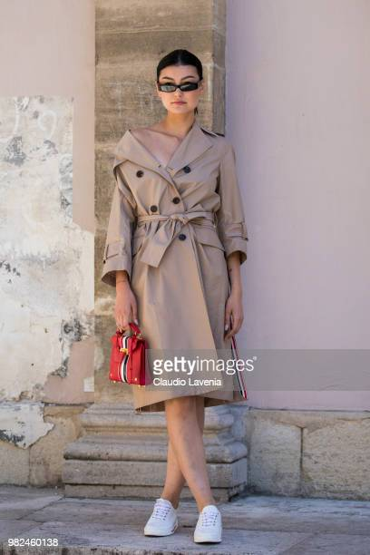 Amalie Gassmann in Thom Browne total look is seen in the streets of Paris before the Thom Browne show during Paris Men's Fashion Week Spring/Summer...