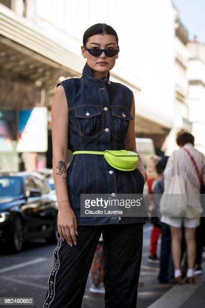 Amalie Gassmann wearing denim jacket Etudes black pants and green belt bag is seen in the streets of Paris after the Etudes show during Paris Men's...