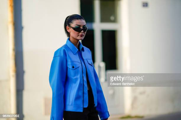 Amalie Gassmann wears a blue coat and sunglasses outside 1017 ALYX 9SM during Paris Fashion Week Menswear SpringSummer 2019 on June 24 2018 in Paris...