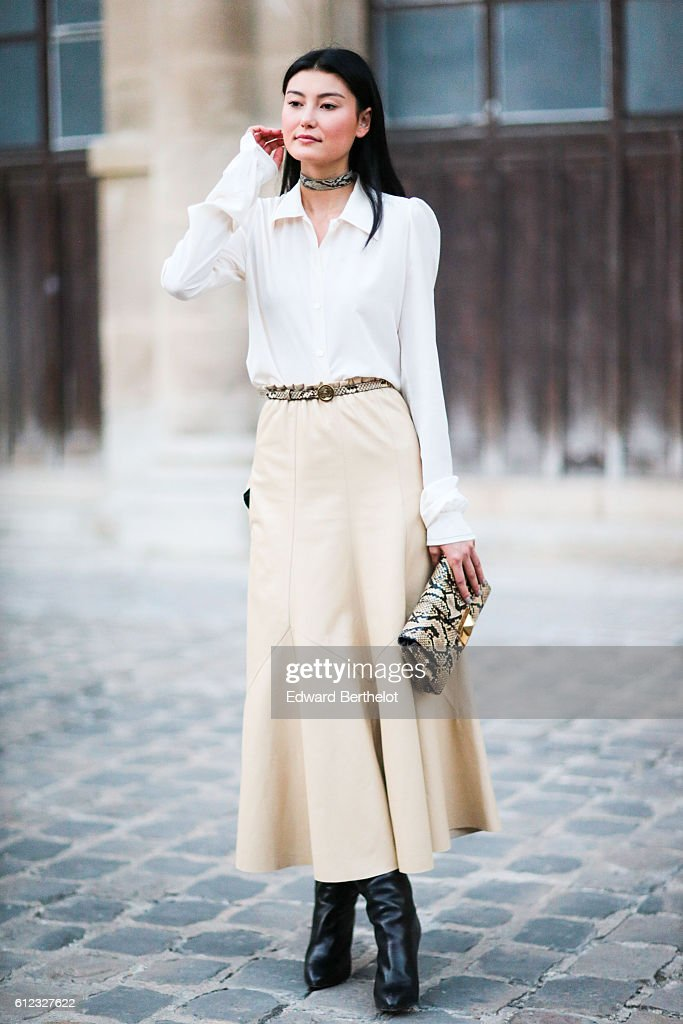 Amalie Gassmann wears a white shirt, a beige skirt, outside of the Sonia Rykiel show during Paris Fashion Week Spring Summer 2017, on October 3, 2016 in Paris, France.