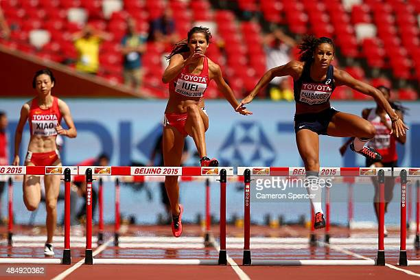 Amalie Iuel of Norway and Aurelie Chaboudez of France compete in the Women's 400 metres hurdles heats during day two of the 15th IAAF World Athletics...