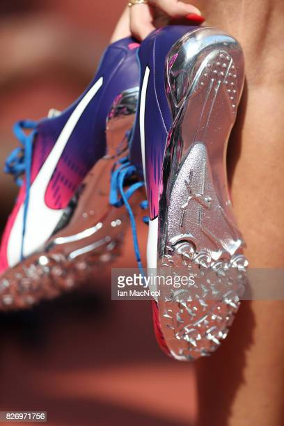 Amalie Iuel of Norway carries her shoes after the Women's 400m heats during day three of the 16th IAAF World Athletics Championships London 2017 at...