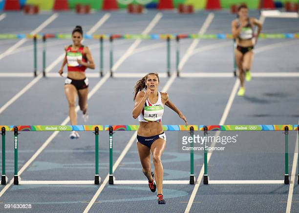 Amalie Iuel of Norway competes during the Women's 400m Hurdles Round 1 on Day 10 of the Rio 2016 Olympic Games at the Olympic Stadium on August 15...