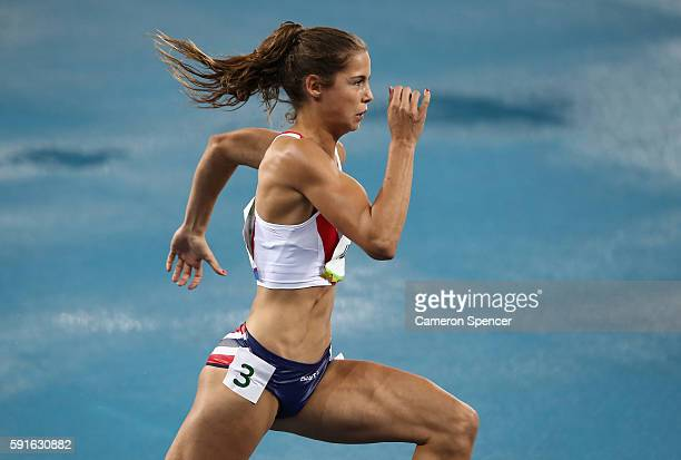 Amalie Iuel of Norway competes during the Women's 400m Hurdles Round 1 on Day 10 of the Rio 2016 Olympic Games at the Olympic Stadium on August 15,...