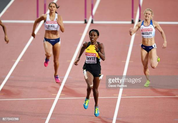 Amalie Iuel of Norway Rhonda Whyte of Jamaica and Meghan Beesley of Great Britain compete in the Women's 400 metres hurdles heats during day four of...