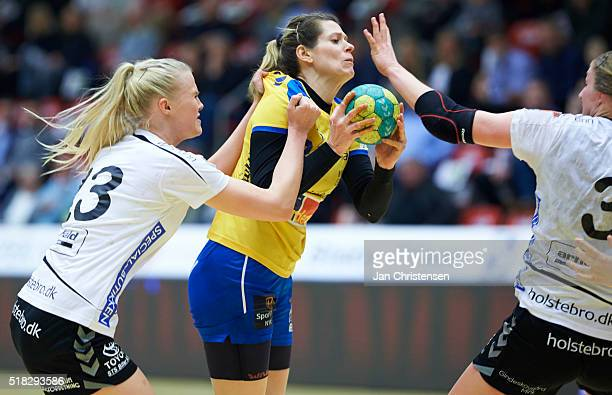 Amalie Wichmann of Team Tvis Holstebro and Deonise Fachinello of Nykobing Falster Handbold challenge for the ball during the Danish Primo Tours...