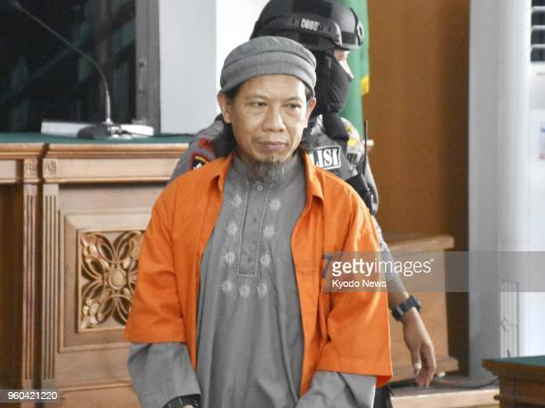 Aman Abdurrahman a spiritual leader of the radical group Jamaah Ansharut Daulah and a key Indonesian Islamic State figure enters a room at the South...