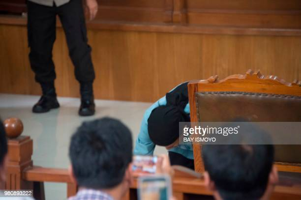 Aman Abdurrahman who masterminded a 2016 gun and suicide attack in the capital Jakarta that left four attackers and four civilians dead kisses the...