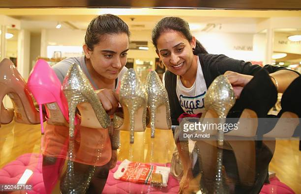 Aman Brad and Ahman Sidhu from Punjab India look at shoes inside the Myer city store during the Boxing Day sales on December 26 2015 in Sydney...