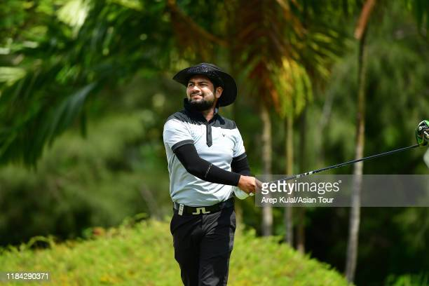 Aman Raj of India reacts after his tee shot during the final round of the Sabah Masters at Sutera Harbour Golf and Country Club on November 24, 2019...