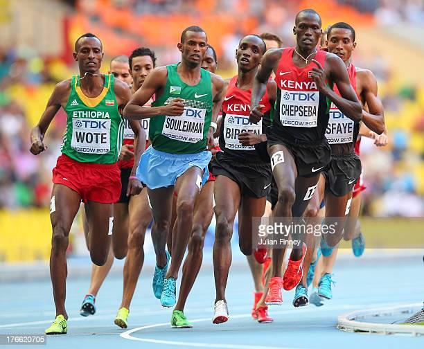 Aman Wote of Ethiopia, Nixon Kiplimo Chepseba of Kenya Ayanleh Souleiman of Djibouti compete in the Men's 1500 metres semi finals during Day Seven of...